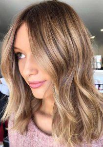 Rubios otoñales que harán brillar tu cabello